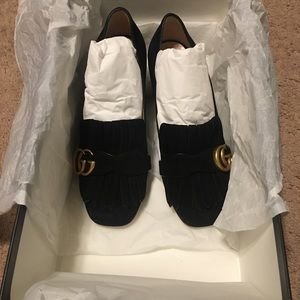 Authentic Gucci shoes .